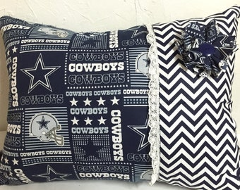 Dallas cowboys pillow for her.