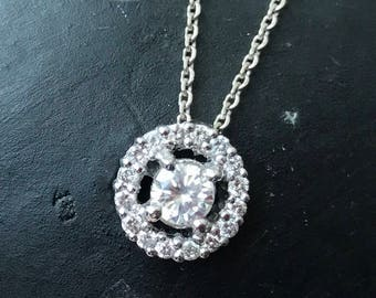White gold and Diamond Halo pendant .48 TCW