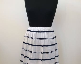 Blue and white striped fabric skirt.