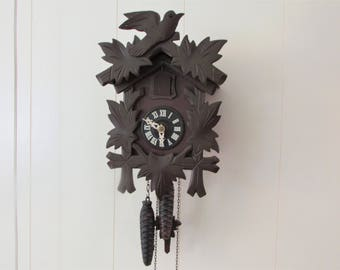 "Vintage German Black Forest Cuckoo Clock/ Bachmaier & Klemmer, small, hand carved wood clock./ 7"" W X 11"" H"