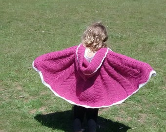 crocheted red riding hood cape.