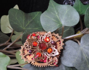 """Sparkling Red"" - inspired steampunk brooch"