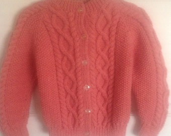 Girls Aran Cardigan. Knitted in a traditional style.