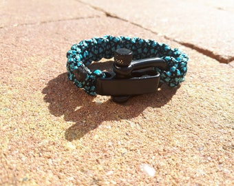 Black blue paracord / survival bracelet with black stainless steel d shackle closure.