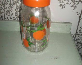 French 1970.s 80.s  retro  vintage screw top glass container jar with bright oranges print -