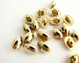 19 golden buttons, small shank buttons in oval shape, unused!