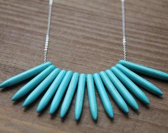 Teal gemstone bullet necklace.