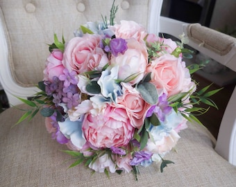 Pastel silk wedding bouquet. Made with artificial roses, peonies, lilac, hydrangea, sweet peas and greenery.