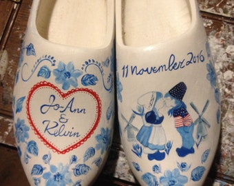 Red white blue handpainted delft blue wooden clogs with heart and kissing farmer and peasant girl with personal text, wedding gift