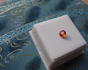 Approximately .80ct 5.5mm Round Spessartite Garnet