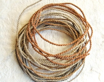 Handmade strings; hemp ropes; linen ropes; waxed threads; strings dyed with onion; jewelry wires.