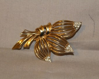 Vintage signed Oucher Gold tone and rhinestone stylized leaf brooch
