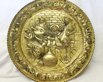 "Vintage Hammered BRASS WALL PLATE Plaque Made in England c1960s Embossed Metal Decor Musicians Tavern Scene Minstrels Bar 16.5"" across"