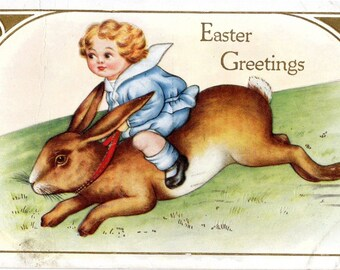Easter Greetings -  Cute little boy in blue riding a bunny - Embossed - 1921 - Vintage Postcard