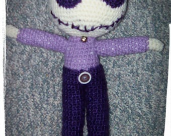 Purple crochet boy doll