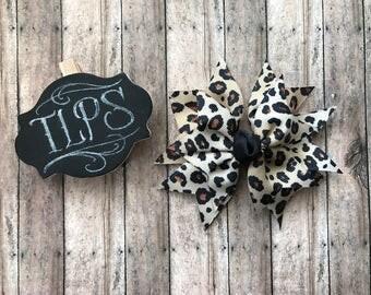 Cheetah print spike bow