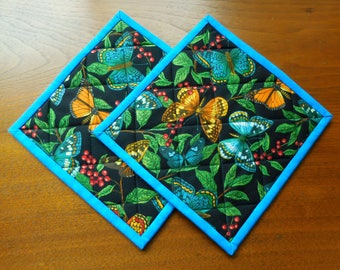 Quilted Pot Holders/ Handmade Quilted/Buterfly Print Fabric in Black, Blue, Green, Yellow/Set of two