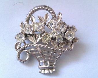 silver coloured flower basket brooch