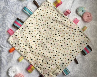 Cotton taggie blanket with minky backing