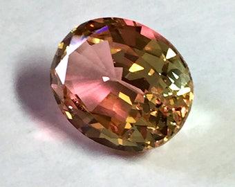 Color change Pink-Yellow #204.Oval 10x8mm. 2.75 Ct. Monosital created gemstone.