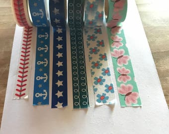 """24"""" sample of one of the choices of washi tape wrapped around a plastic bobbin. The perfect amount to decorate a scrapbook or planner page"""