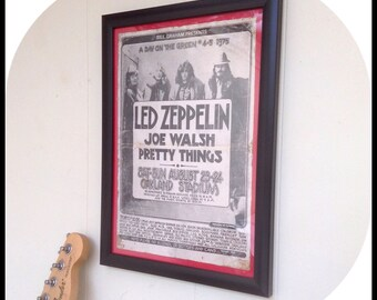 Aged reproduction Led Zeppelin gig poster in frame.