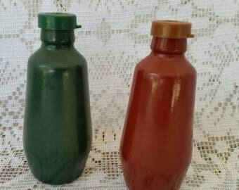 Vintage MidCentury Salt and Pepper Shakers in classic green and rust red. Incredible Condition. Must See
