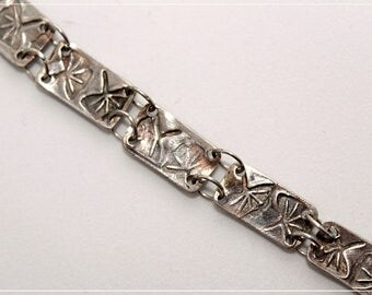 Silver bracelet with ginko leaves impressions