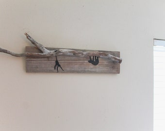 South American silhouette driftwood scene-spider monkey and sloth