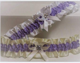 Wedding garter/Bridal garter. White or Ivory satin with purple trims. Diamante cluster detail & something blue added