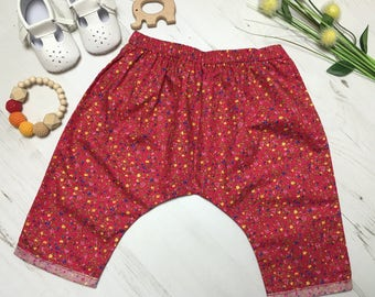 Red ditsy floral girls harem pants. Drop crotch style, cotton harems. 3 months - 6 years