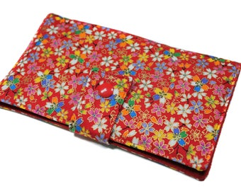 checkbook holder in Japanese fabric with small multicolored flowers