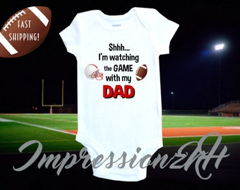 Cute football one-piece bodysuit shirt- funny baby shirt - Shh I'm watching football with my DAD -football fan shirt