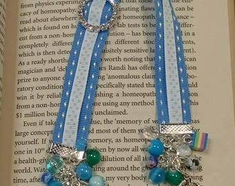 Blue and white ribbon bookmark with beads and orangutan charms