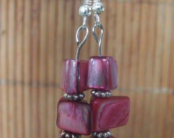Dark pink pearl earrings and silver metal
