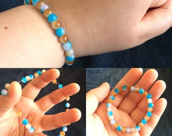 Blue, Brown, and White Beaded Bracelet