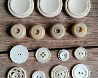 Selection of cream vintage buttons.