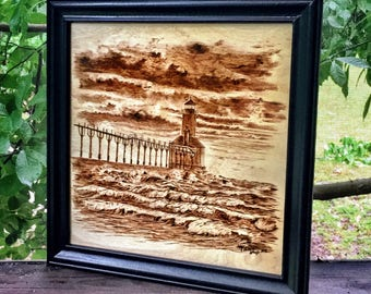 Handmade Woodburning of lighthouse in stormy seas
