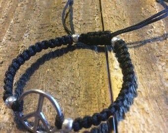 Blace macrame bracelet with a peace sign