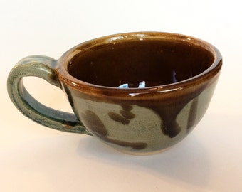 Brown and turquoise ceramic mug