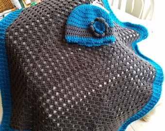 Baby blanket with matching hat in turquoise and pewter.