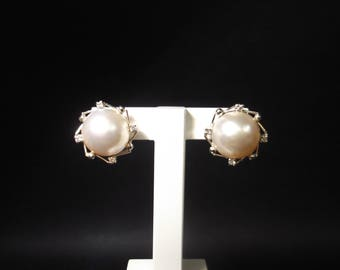 18Kt white gold earrings, Japanese pearl and four brilliants