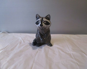 a ceramic bisque racoon