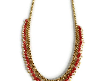 Dainty necklace made of Red coral and tiny pearls on a necklace made of stainless steel.