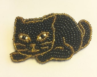 Beaded black and gold cat pin