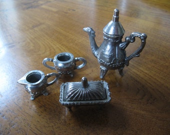 "For the dollhouse ... a miniature ""silver"" coffee / milk / sugar and butter dish ... c. 1950!"