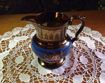 Vintage Victorian / Edwardian large copper lustre jug/ pitcher decorated with blue glaze and raised pink roses