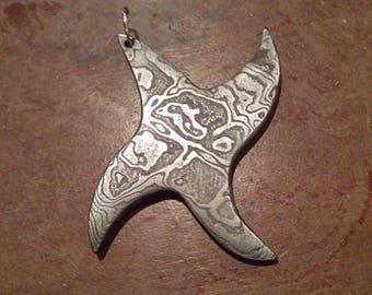 Damascus tribal spike pendant