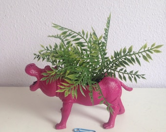 Olivia, the magenta hippo, with realistic plant