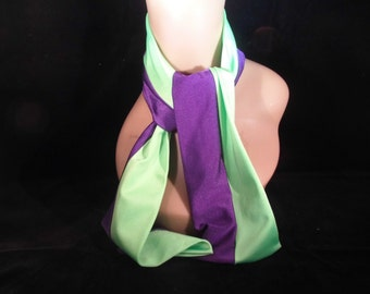Purple and lime scarf wear around neck.